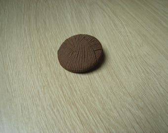 large button has a Brown plastic tail decor