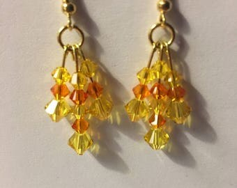 Swarovski crystals dangle earrings.