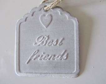 "metal with inscription ""Best friends"" tag with ""best friend"" cord"