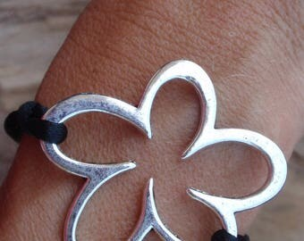 Black cord and Silver Flower bracelet.