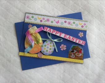 Easter, a blue background, eggs and chicken card