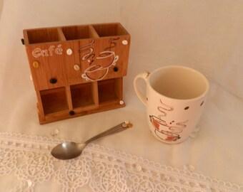 Distributor of Nespresso coffee pod and her mug