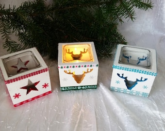 set of 3 candles made of 2 Christmas reindeer and 1 star