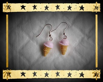 Vanilla ice cream cone and pink ball on silver plated