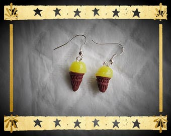 Chocolate ice cream cone and his yellow ball mounted on silver plated