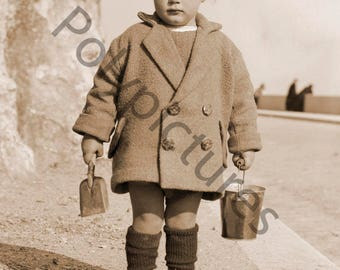 Old toddler with a bucket and shovel Beach photo print