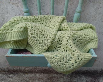 Green baby blanket crocheted by hand