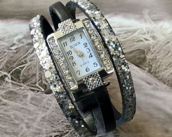 Ladies size watch. XS. Shows rectangular silver metal and rhinestone sequin silver magnetic clasp leather bracelet