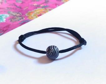 Zebra white black bead and black satin cord sliding knot bracelet