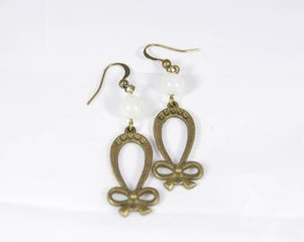 beautiful earrings of frosted glass bead and bronze metal