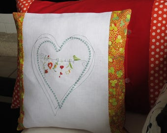 Embroidered pattern of intertwined hearts cushion