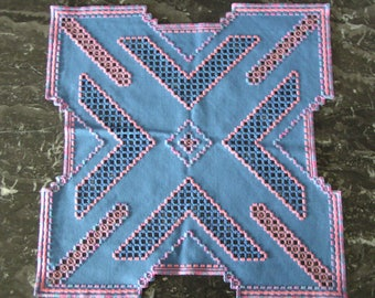 Square doily embroidered in Hardanger blue and pink