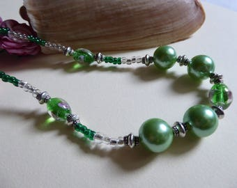 Green oval beads necklace with flower rose