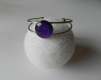 Metallic purple bracelet has glitter
