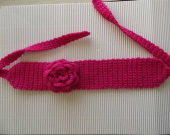 Pink flashy adorned with a pink crochet headband