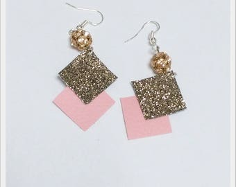 pink geometric earrings and sequined