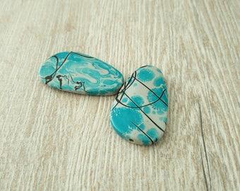 Plastic black marbled blue beads