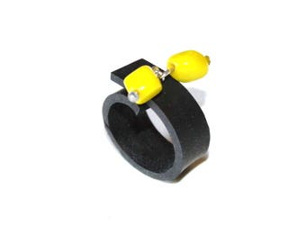 Ring in inner tube recycled car lemon yellow