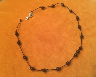 Knotted black bead necklace