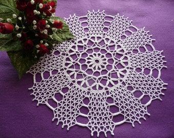 Handmade white cotton lace doily.