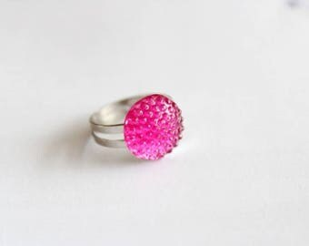 Ring with pink plastic pendant