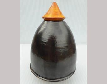 Orange and black oval box