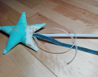 Magic wand to disguise blue sequin fabric