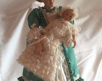 "Danbury Mint ""Christening Day"" Porcelain Dolls"