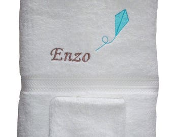 Towel embroidered with a name and a kite