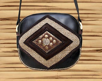 Small ethnic shoulder bag in inner tube recycled and Medallion brass diamond shape