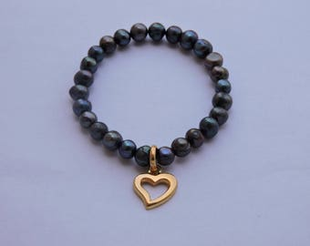 Heart bracelet in black beads and gold plated sterling silver