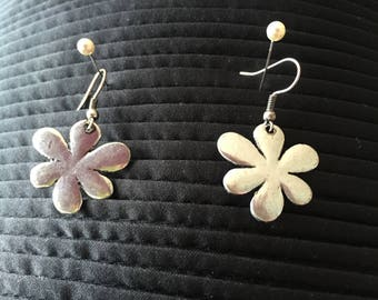 Silver coloured daisy dangly earrings