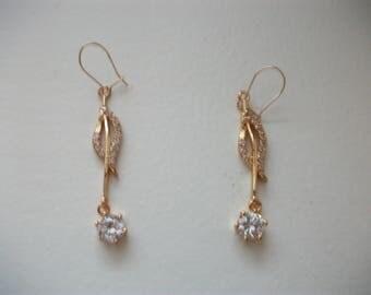 Earrings in 14 k diamond and rhinestone.