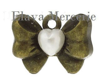 x 1 bow charm with small white heart cabochon