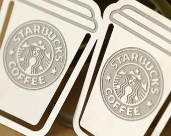Starbucks bookmark, paperclip.