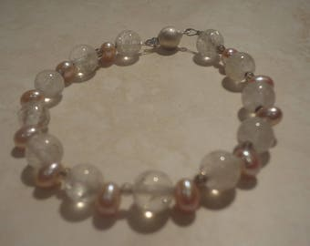 Pearl, smokie quartz and rock crystal with silver clasp