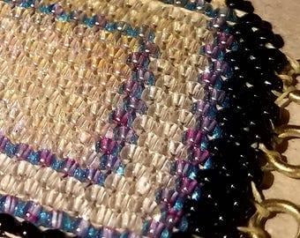 Transparent, iridescent, lavender peyote stitch beaded bracelet
