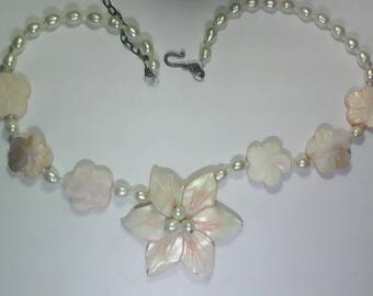 Vintage Fresh water pearl necklace with carved mother of pearl flower.