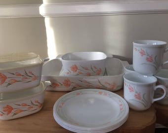 Peach Floral Corningware 4 Piece Set with two small lids and coordinating 4 Piece Coffee/Tea cups and 4 dessert plates by Corelle