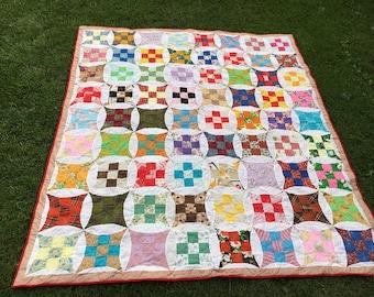 Hand pieced queen sized quilt