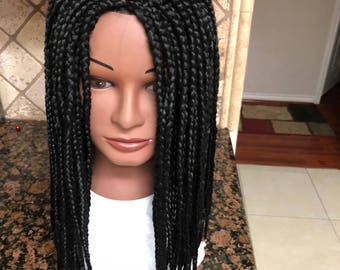 Braided wig;shoulder length,thin corn row infront,a little loose box braids-unique tips. Color black.14 inches long.