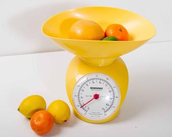 Bright yellow vintage retro Soehnle plastic kitchen weighing scales for baking and cooking