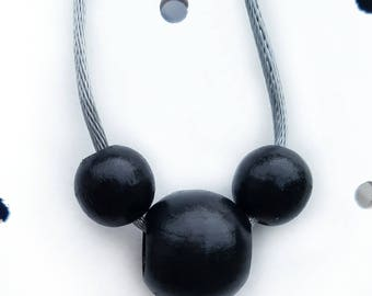 Simple mouse ears necklace.