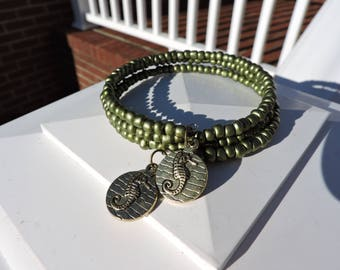 Stackable seahorse charm adds beauty to this green stone memory wire bracelet