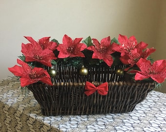 Gift basket with red flowers and gold ornaments