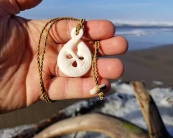 Polynesian Bone pendant with infinity twist