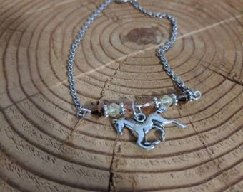 Horse bracelet with brown and natural color beads on a bar on silver stainless steel chain