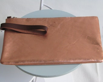 Copper woman with wrist strap leather pouch