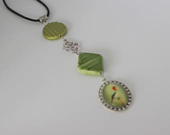 Original vertical necklace in green, silver acrylic and bird.
