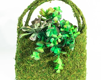 Moss-covered handbag with artificial succulents